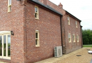 Old large farmhouse or just very good brick match on the extension?? 3