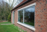 Elite 92, triple glazed, inward opening timber windows and matching doors. North Nottinghamshire.